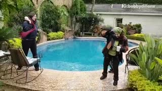 Boy falls into pool during snowball fight