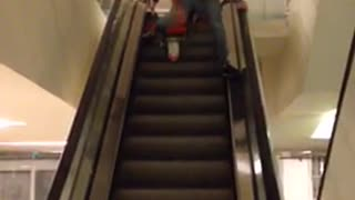 Escalator bike ride falls over handle bars angle 1 - Video
