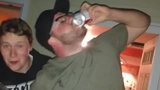 Guy in green shirt drinking beer and spilling it everywhere  - Video