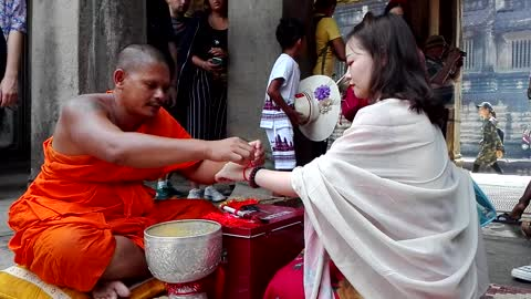 very cute Chinese girl needs sacred water from my monk