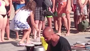Elderly man hilariously dances to street percussionist - Video