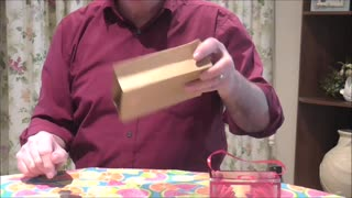 Flower Boxes Materalise From An Empty Paper Bag  - Video