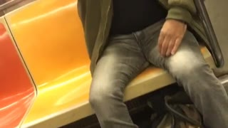 Man green bomber jacket shaving on subway