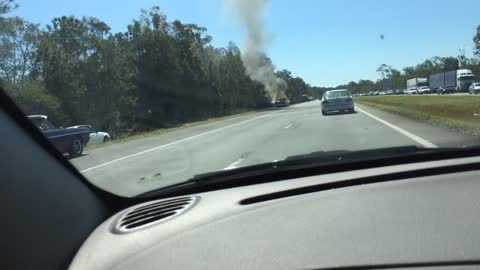 Classic 1955 Chevrolet catches fire on side the highway