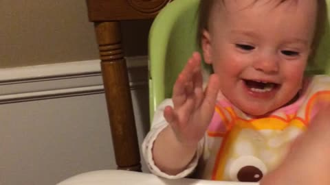 Baby gives high fives