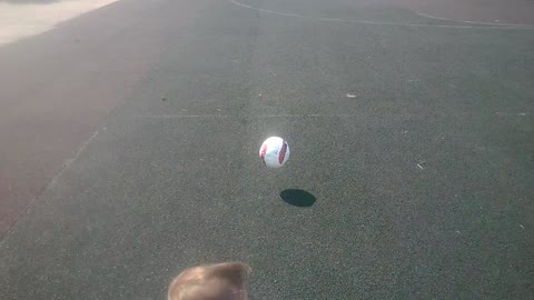 The little girl playing with ball