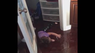 Baby Creates Her Own Indoor Slip And Slide - Video