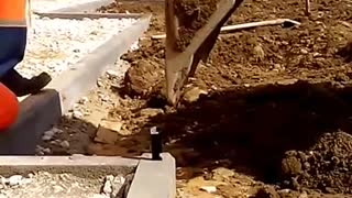 Power shovel lights cigarette for construction worker - Video