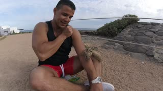 Playing with a little barbary ground squirrel - Video