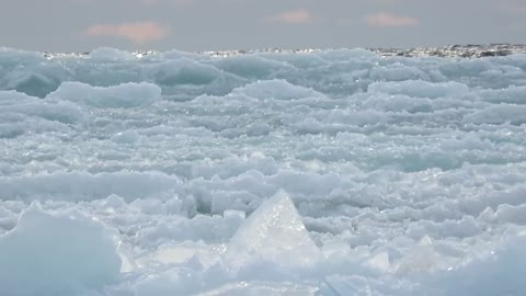 Waves of ice cover frozen surface of Lake Superior