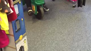 2 year old tries to steal thrift store tractor and makes a getaway