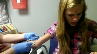 Teen Freaks Out While Getting Blood Drawn - Video