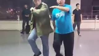 Grandfather duo bust out awesome dance moves - Video