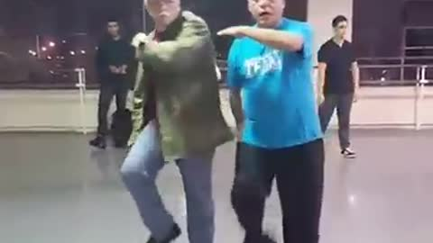 Two Elderly Men Show Off Some Smooth Dance Moves, Getting To The Groove