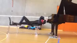 Playing the piano upside down and blindfolded!