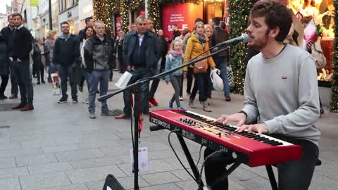 Street performer in Dublin wows crowd with Beatles cover