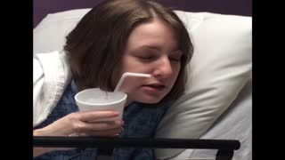 Drugged up woman cannot reach straw - Video