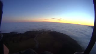 Ocean of clouds while paragliding over Carpathian Mountains - Video
