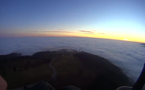 Ocean of clouds while paragliding over Carpathian Mountains