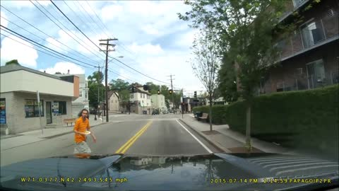 Dash cam footage captures pedestrian's odd behavior