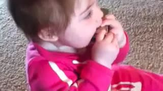 Adorable baby plays harmonica