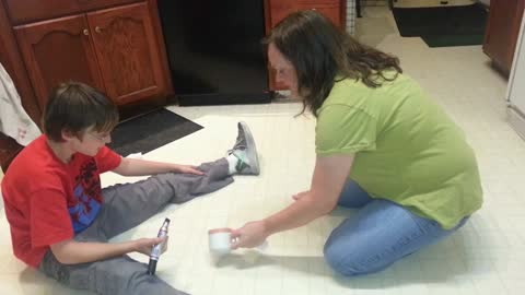 Mom and son have unusual cleaning routine