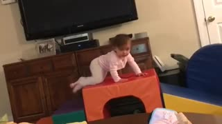 Collab copyright protection - baby girl pink falls off orange toy - Video