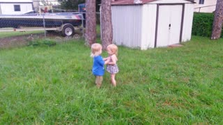 Toddler boy tries to land his first kiss - Video