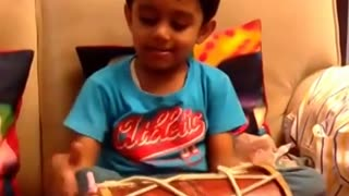 Amazing 3 year old playing the dholak and singing