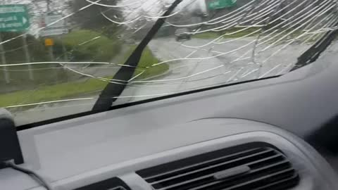 Man Bashes Windshield on Moving Car