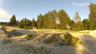 Guy rides electric mountain bike off ramp and lands on front wheel, face plants