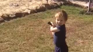 Toddler crushes baseball - Video