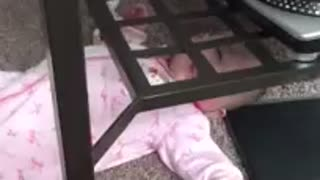 Baby stuck under table, so cute - Video