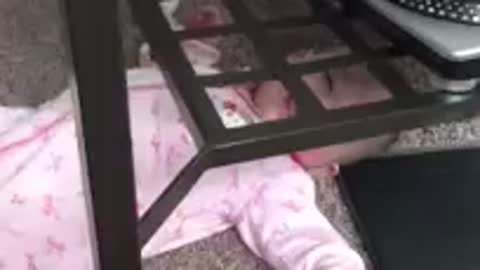 Baby stuck under table, so cute