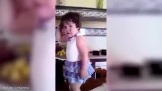 Cute toddler stops crying to strike a pose