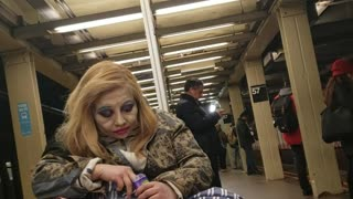 Woman puts on a lot of makeup and looks like a clown, subway station