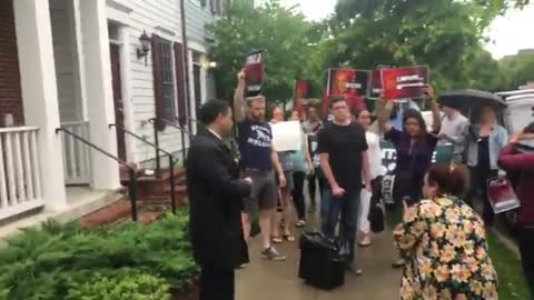 Protestors outside DHS Secretary Kirstjen Nielsen's home, playing crying baby audio