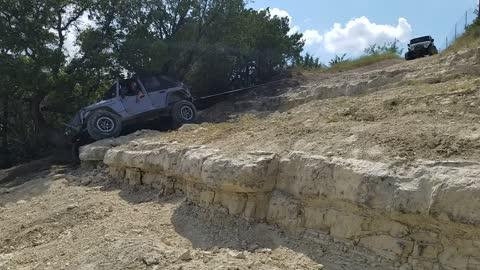 Jeep on a winch to save it from going over