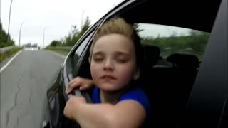 Kid driving with Wind in her face - Video
