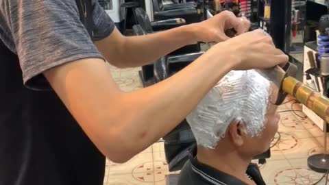 Barber Shaves Customer's Head with Sword