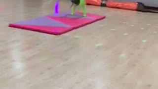 Neon green backflip purple foam pad falls on floor gymnastics girl - Video