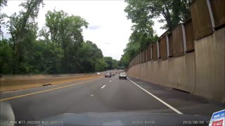Runaway Tire Smashes Into Oncoming Traffic - Video