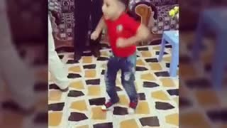 A very kid doing amazing dancing step in marriage ceremony in arab  - Video