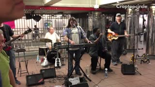 Band four people playing in subway
