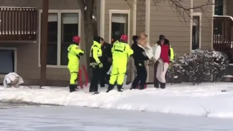The dog fell into the frozen pool. The firemen started to rescue