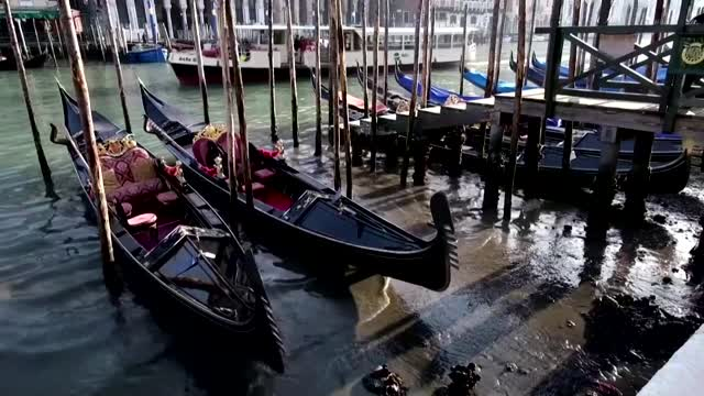 Low tide leaves famous Venice canals almost empty