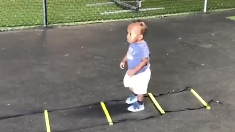 The Adorable Kid Copies Dad On Ladder Drill