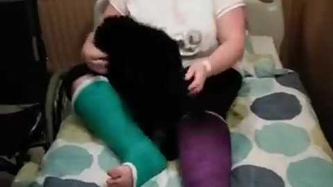 Woman reunited with puppy after two weeks in hospital