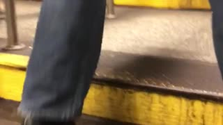 Man rides motorized suitcase out of stairs - Video