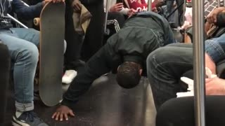 Guy doing 100 push ups on train for crowd